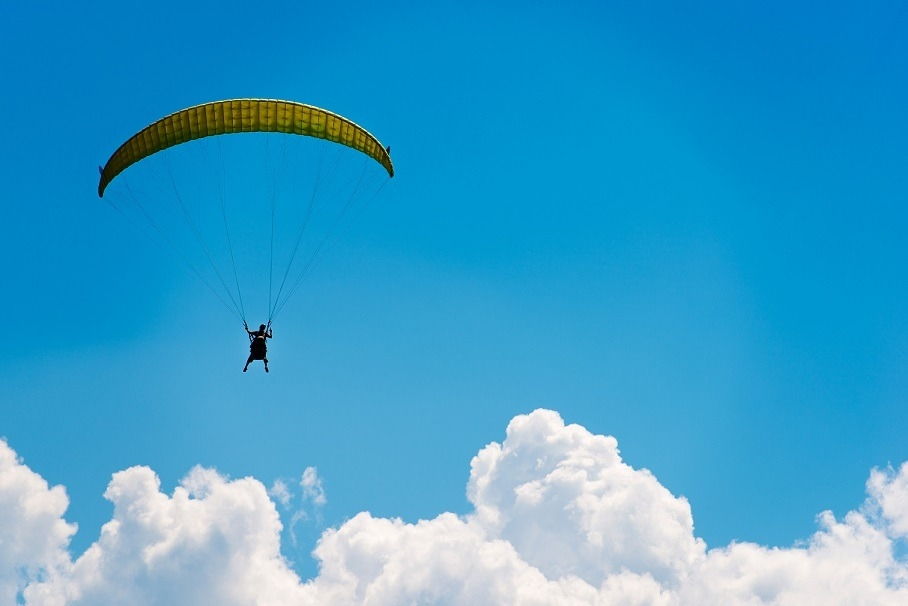 Parachute Over Blue Sky. Parachute Fly. Extreme Sports Concept Photo.