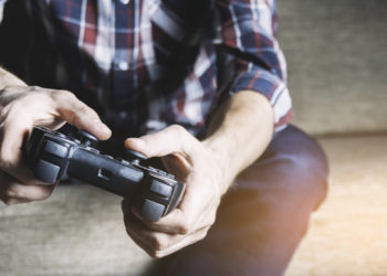 Game joystick in the hands of men